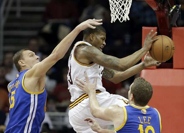 Golden State Warriors' Andris Biedrins, left, fouls Cleveland Cavaliers' Alonzo Gee during the first quarter of an NBA basketball game Tuesday, Jan. 29, 2013, in Cleveland. (AP Photo/Mark Duncan) Photo: Mark Duncan, Associated Press