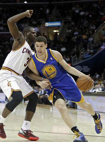 Klay Thompson, whose 32 points were a career high, drives on Dion Waiters. Thompson was 13-for-24 from the floor. Photo: Mark Duncan, Associated Press