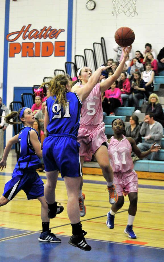 Danbury's Rachel Gartner shoots over Darien's Meg Marren during their game at Danbury High School on Tuesday, Jan. 29, 2013. Danbury won, 51-44. Photo: Jason Rearick / The News-Times