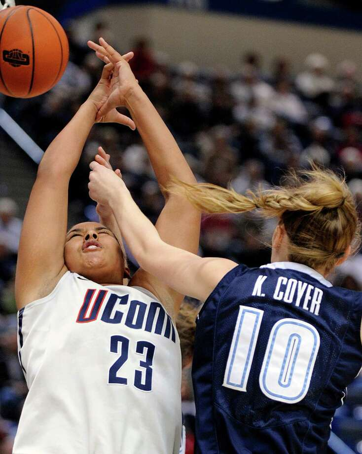 Connecticut's Kaleena Mosqueda-Lewis, left, is fouled by Villanova's Katherine Coyer during the second half of Connecticut's 76-43 victory in an NCAA college basketball game in Hartford, Conn., Tuesday, Jan. 29, 2013. (AP Photo/Fred Beckham) Photo: Fred Beckham, Associated Press / FR153656 AP