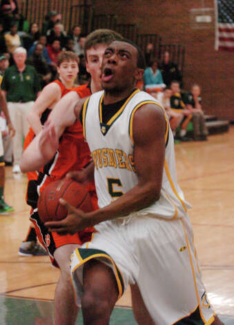 Trinity's Brandon Wheeler in action as Trinity Catholic hosts Ridgefield High School in a boys basketball game in Stamford, Conn., Jan. 29, 2013. Photo: Keelin Daly / Keelin Daly
