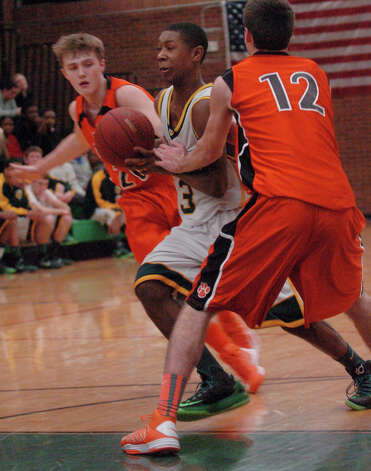Trinity's Tremain Fraiser breaks through the Ridgefield defense as Trinity Catholic hosts Ridgefield High School in a boys basketball game in Stamford, Conn., Jan. 29, 2013. Photo: Keelin Daly / Keelin Daly