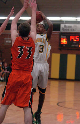 Trinity's Tremain Fraiser shoots as Trinity Catholic hosts Ridgefield High School in a boys basketball game in Stamford, Conn., Jan. 29, 2013. Photo: Keelin Daly / Keelin Daly