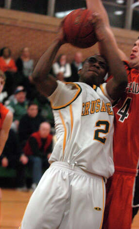Trinity's Schadrac Casimir in action as Trinity Catholic hosts Ridgefield High School in a boys basketball game in Stamford, Conn., Jan. 29, 2013. Photo: Keelin Daly / Keelin Daly