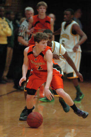 Ridgefield's Charlie Irwin in control as Trinity Catholic hosts Ridgefield High School in a boys basketball game in Stamford, Conn., Jan. 29, 2013. Photo: Keelin Daly / Keelin Daly