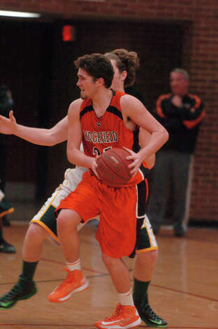 Ridgefield's John Hicks in action as Trinity Catholic hosts Ridgefield High School in a boys basketball game in Stamford, Conn., Jan. 29, 2013. Photo: Keelin Daly / Keelin Daly