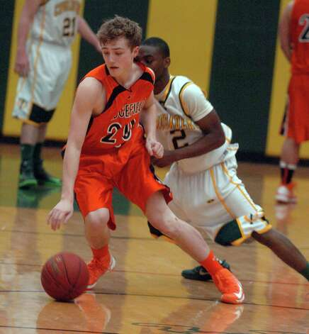 Ridgefield's Matt Brennan in action as Trinity Catholic hosts Ridgefield High School in a boys basketball game in Stamford, Conn., Jan. 29, 2013. Photo: Keelin Daly / Keelin Daly
