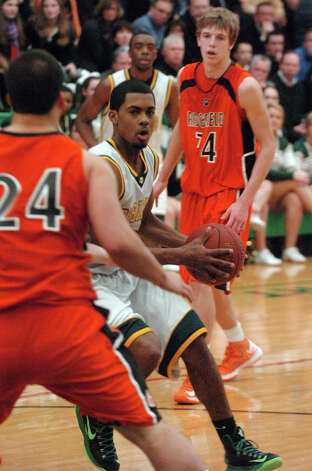 Trinity's Neno Merritt in action as Trinity Catholic hosts Ridgefield High School in a boys basketball game in Stamford, Conn., Jan. 29, 2013. Photo: Keelin Daly / Keelin Daly