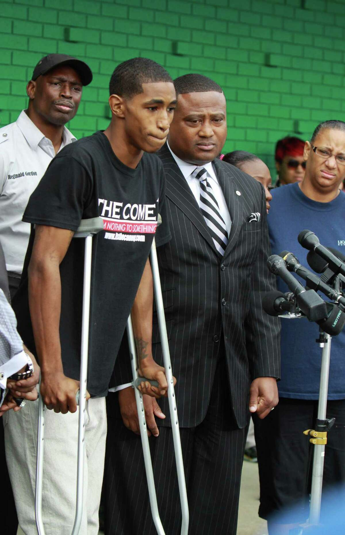 Carlton Berry, on crutches alongside activist Quanell X and other community leaders, asked Sheriff Adrian Garcia for an apology Tuesday after the Lone Star College student was cleared of charges in last week's campus shooting.