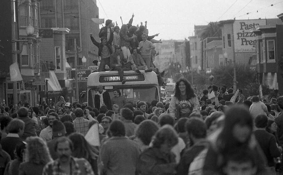 Fans celebrating the 49ers Super Bowl XVI win celebrate by climbing on top of a Muni bus on Union Street. Jan. 24, 1982. Photo: Eric Luse, The Chronicle