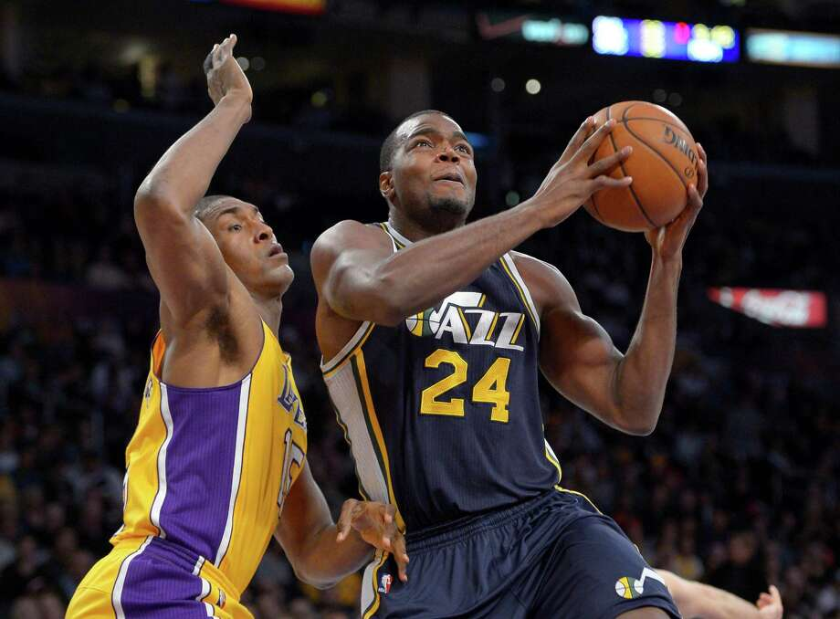 The Jazz's Paul Millsap, right, may be on the trading block but also is a free agent after the season. Photo: Mark J. Terrill, STF / AP