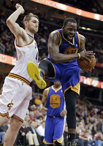 Golden State Warriors' Draymond Green (23) pulls down a rebound against Cleveland Cavaliers' Tyler Zeller in the fourth quarter of an NBA basketball game Tuesday, Jan. 29, 2013, in Cleveland. The Warriors won 108-95. (AP Photo/Mark Duncan) Photo: Mark Duncan, Associated Press
