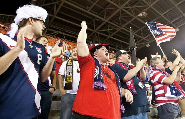 Jason Bordelon of Baton Rouge cheers as the U.S. men's soccer team warms up for a international friendly soccer game against Canada at BBVA Compass Stadium. Photo: Nick De La Torre, Houston Chronicle / © 2013  Houston Chronicle
