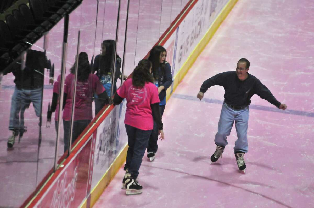 Amy, Jordon, and Scott Robey skate on the pink ice during the San Antonio Rampage Pink in the Rink Skate on Jan. 29. The ice at the AT&T Center is pink to commemorate breast cancer awareness.