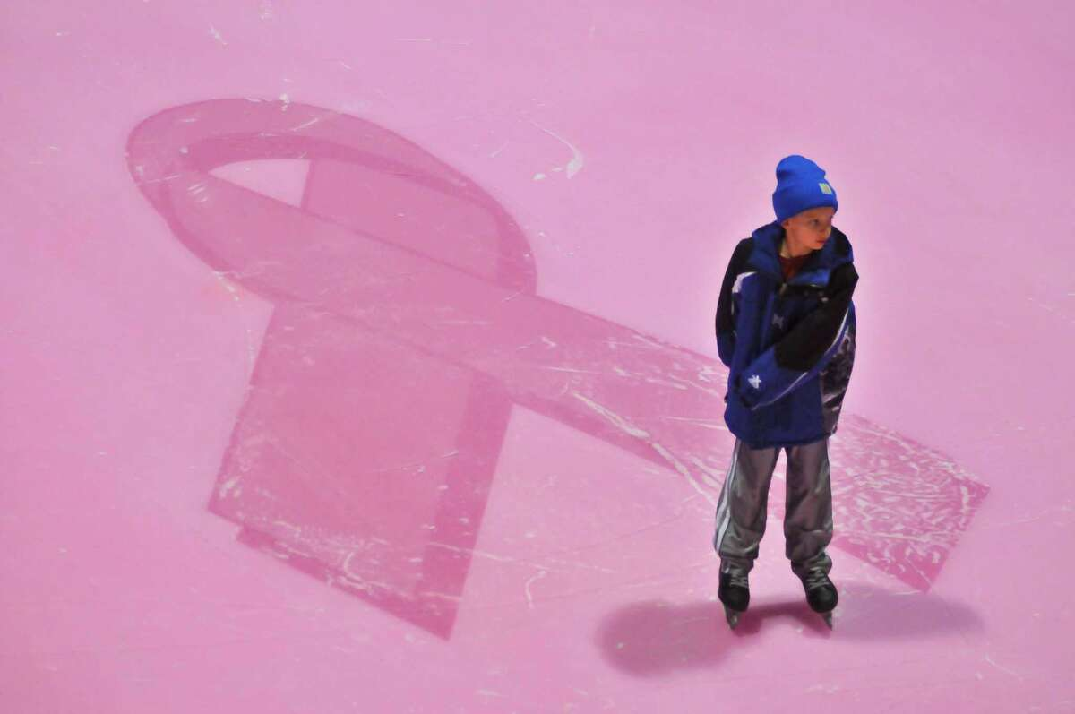 Nathan Rawe, 9, skates on the pink ice during the San Antonio Rampage Pink in the Rink Skate on Jan. 29. The ice at the AT&T Center is pink to commemorate breast cancer awareness.