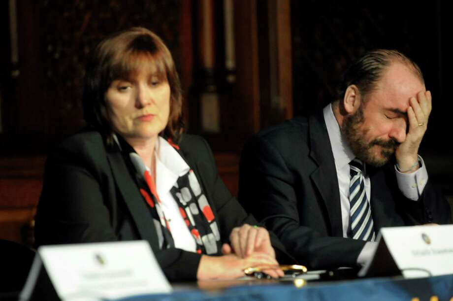 Ciaran Staunton of Queens, right, and his wife, Orlaith, react when Ciaran retells the story of the death of their son, Rory, during a news conference on Tuesday, Jan. 29, 2013, at the Capitol in Albany, N.Y. Rory Staunton died at the age of 12 from sepsis. (Cindy Schultz / Times Union) Photo: Cindy Schultz / 00020951A