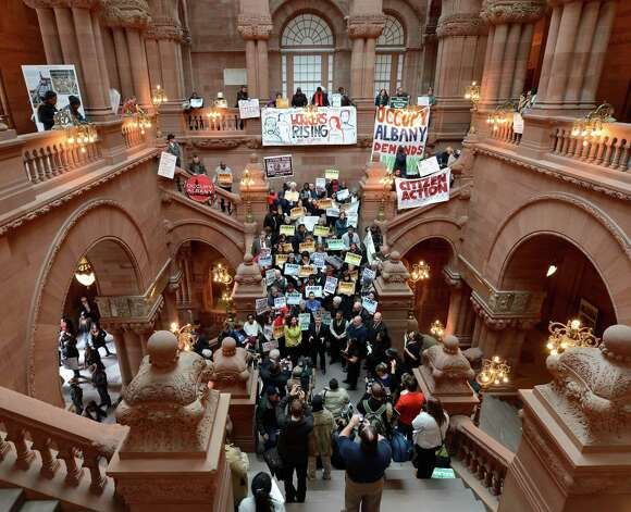 Demonstrators line the Million Dollar staircase in the State Capitol Jan. 29, 2013 to voice their want for a higher minimum wage in Albany, N.Y.    (Skip Dickstein/Times Union) Photo: SKIP DICKSTEIN / 00020940A