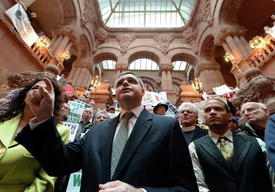New York State AFL-CIO President Mario Cilento joins demonstrators on the Million Dollar staircase in the State Capitol Jan. 29, 2013 to voice their want for a higher minimum wage in Albany, N.Y.    (Skip Dickstein/Times Union) Photo: SKIP DICKSTEIN / 00020940A