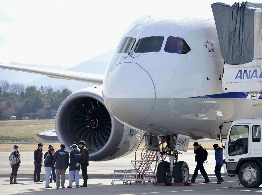 FILE - In this Jan. 18, 2013 file photo, officials inspect an All Nippon Airways Boeing 787 which made an emergency landing at Takamatsu airport in Takamatsu, western Japan. The joint U.S. and Japanese investigation into the plane's battery problems has shifted from the battery-maker to the manufacturer of a monitoring system Monday, Jan. 28, 2013. (AP Photo/Kyodo News)  JAPAN OUT, MANDATORY CREDIT, NO LICENSING IN CHINA, HONG KONG, JAPAN, SOUTH KOREA AND FRANCE Photo: SUB / Kyodo News