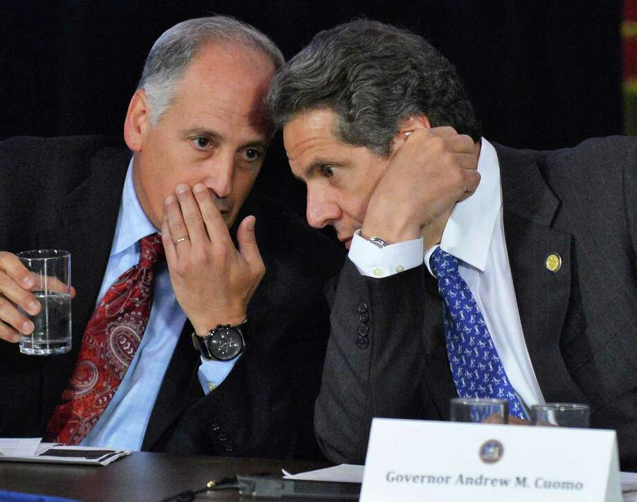 Gov. Andrew Cuomo, right, and Secretary to the Gov., Larry Schwartz, confer during a Cabinet meeting at the Capitol Wednesday May 9, 2012, in Albany, N.Y.  (John Carl D'Annibale / Times Union archive) Photo: John Carl D'Annibale / 00017616A