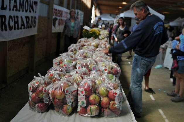 Apples from Altamont Orchards are for sale during the 20th annual Capital Region Apple and Wine Festival at the Altamont Fairgrounds, on Sunday Sept. 16, 2012 in Altamont, NY.   (Philip Kamrass / Times Union) Photo: Philip Kamrass / 00019231A