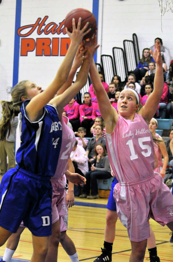 Darien's Kate Fiore and Danbury's Rebecca Gartner compete for the rebound during their game at Danbury High School on Tuesday, Jan. 29, 2013. Danbury won, 51-44. Photo: Jason Rearick / The News-Times