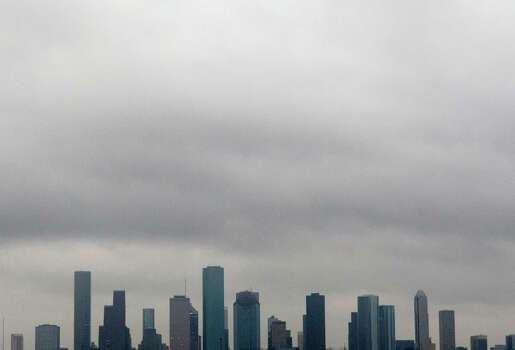 Clouds hang over downtown Tuesday, Jan. 29, 2013, in Houston. Photo: Cody Duty, Houston Chronicle / © 2013 Houston Chronicle