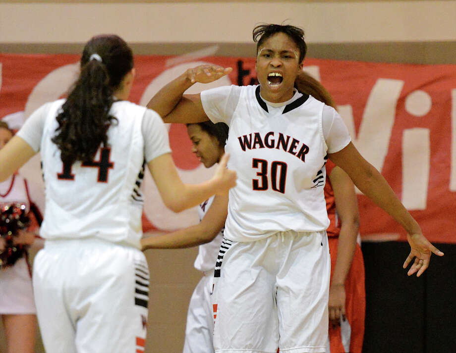 Wagner's Tesha Smith (30) celebrates after hitting a shot while being fouled during a district 25-5A girls Basketball game between the Wagner Thunderbirds and the Judson Rockets at Wagner High School, Tuesday, January 29, 2013. Photo: John Albright, For The Express-News / San Antonio Express-News