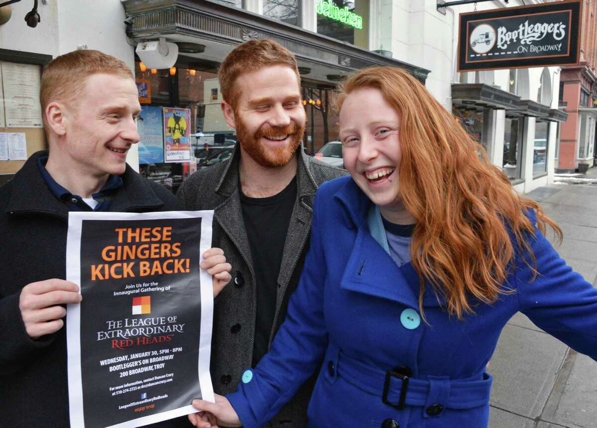 Members of the League of Extraordinary Redheads, from left, Kenny DuBois, Margaret Young and Duncan Crary outside Bootleggers on Broadway in Troy Tuesday Jan. 29, 2013, site of Wedneday's inaugural meeting. (John Carl D'Annibale / Times Union)