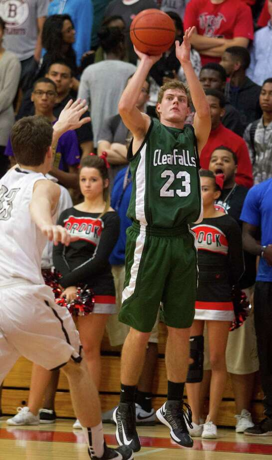 Clear Falls Matt Ketzer (23) puts up a shot over Clear Brook's Brandon Conner (33). Photo: J. Patric Schneider, For The Chronicle / © 2013 Houston Chronicle
