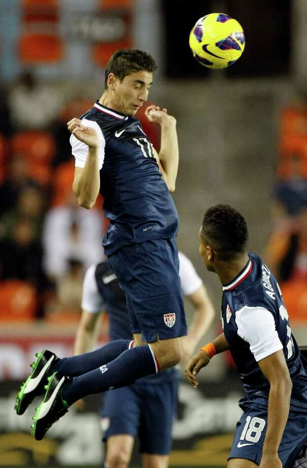 USA's Alejandro Bedoya leaps to head the ball to a teammate during the second half. Photo: Nick De La Torre, Houston Chronicle / © 2013  Houston Chronicle