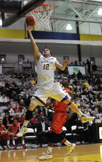 UAlbany's Peter Hooley goes in for a basket during their men's college game against Stony brook at t