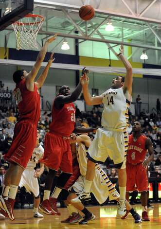 UAlbany's Sam Rowley goes in for a basket during their men's college game against Stony brook at the SEFCU Arena on Tuesday Jan. 29,2013 in Albany, N.Y. (Michael P. Farrell/Times Union) Photo: Michael P. Farrell