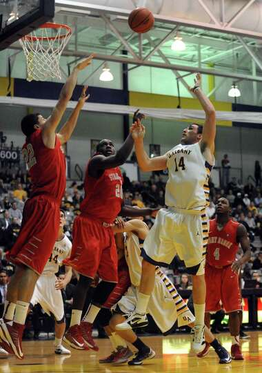 UAlbany's Sam Rowley goes in for a basket during their men's college game against Stony brook at the