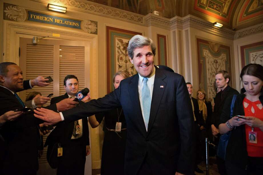 Sen. John Kerry, D-Mass., emerges after a unanimous vote by the Senate Foreign Relations Committee approving him to become America's next top diplomat, replacing Secretary of State Hillary Rodham Clinton, on Capitol Hill in Washington, Tuesday, Jan. 29, 2013. Kerry, who has served on the Foreign Relations panel for 28 years and led the committee for the past four, is expected to be swiftly confirmed by the whole Senate later Tuesday.   (AP Photo/J. Scott Applewhite) Photo: J. Scott Applewhite