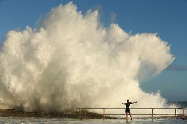 Hit me with your best shot: A massive wave spawned in the wake of the former cyclone Oswald crashes next to a man at the North Curl ocean pool in Sydney. Photo: Cameron Spencer, Getty Images