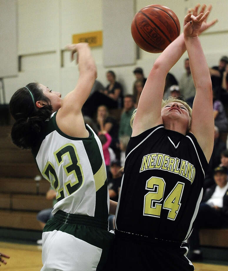 Lady Bear Grace Chen, #23, swats away Lady Bulldog Anna Simpson, #24, shot during the Little Cypress-Mauriceville girls basketball game against Nederland on Tuesday, January 29, 2013, at LC-M.  LC-M won over Nederland in overtime 50 - 48. Photo taken: Randy Edwards/The Enterprise