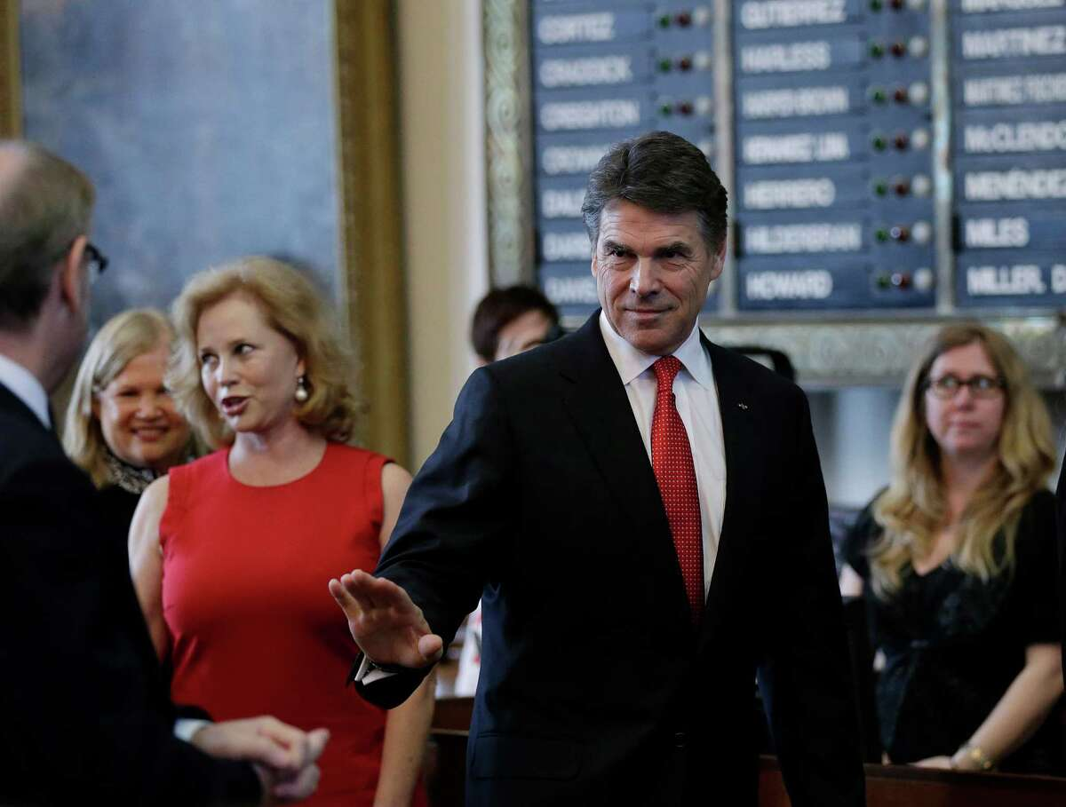 Texas Gov. Rick Perry, right, and his wife, Anita, arrive for his state of the state address in the house chambers at the state capitol, Tuesday, Jan. 29, 2013, in Austin, Texas. (AP Photo/Eric Gay)