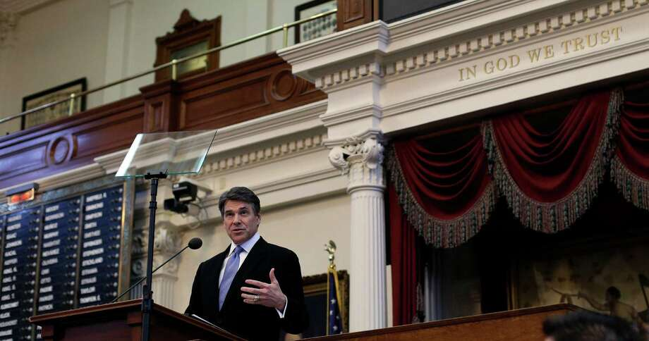 Texas Gov. Rick Perry addresses the opening session of the 83rd Texas Legislature, Tuesday, Jan. 8, 2013, in Austin, Texas. Texas legislators opened their 140-day session Tuesday poised to debate how to pay for public schools, decide whether to drug test unemployment recipients and possibly confront a mounting water crisis under the strain of a rapidly growing population. (AP Photo/Eric Gay) Photo: Eric Gay, STF / AP