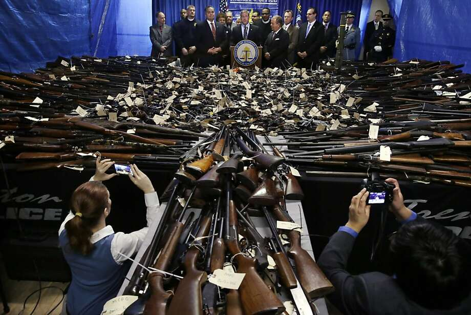New Jersey Attorney General Jeffrey S. Chiesa, center at podium, stands with other officials, Tuesday, Jan. 29, 2013, in Trenton, N.J., as he announces that the gun buyback program last Friday and Saturday in the state's capital brought in over 2,600 guns, including 700 that were illegal.  Photo: Mel Evans, Associated Press
