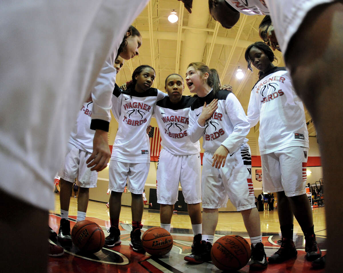 Wagner's Corrina Moncada talks to her teammates in a circle at mid-court before a district 25-5A girls Basketball game between the Wagner Thunderbirds and the Judson Rockets at Wagner High School, Tuesday, January 29, 2013.