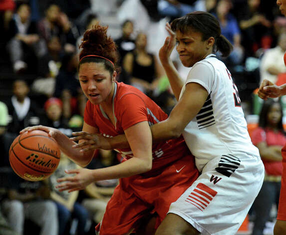 Judson's Lajeah Rice (left) tries to get around Wagner's Tesha Smith (right) during a district 25-5A girls Basketball game between the Wagner Thunderbirds and the Judson Rockets at Wagner High School, Tuesday, January 29, 2013. Photo: John Albright, For The Express-News / San Antonio Express-News