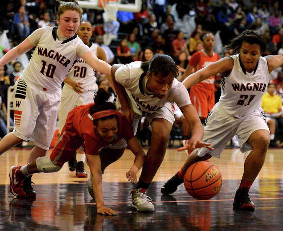 Wagner's Tesha Smith (30) and Judson's Smantha Allen (11) scrabble for a loose ball  during a district 25-5A girls Basketball game between the Wagner Thunderbirds and the Judson Rockets at Wagner High School, Tuesday, January 29, 2013. Photo: John Albright, For The Express-News / San Antonio Express-News