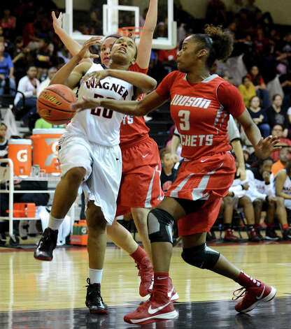 Wagner's Ashley Ross (20) has the ball knocked away by Judson's LeQeisha Brown (3)  during a district 25-5A girls Basketball game between the Wagner Thunderbirds and the Judson Rockets at Wagner High School, Tuesday, January 29, 2013. Photo: John Albright, For The Express-News / San Antonio Express-News
