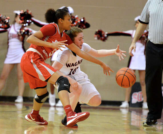 Judson's Shameka Brown (5) pokes the ball away from Wagner's Corrina Moncada (10) during a district 25-5A girls Basketball game between the Wagner Thunderbirds and the Judson Rockets at Wagner High School, Tuesday, January 29, 2013. Photo: John Albright, For The Express-News / San Antonio Express-News