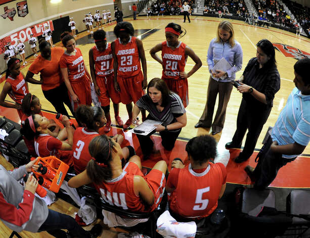Judson head coach Triva Corrales talks to her team during a timeout during a district 25-5A girls Basketball game between the Wagner Thunderbirds and the Judson Rockets at Wagner High School, Tuesday, January 29, 2013. Photo: John Albright, For The Express-News / San Antonio Express-News