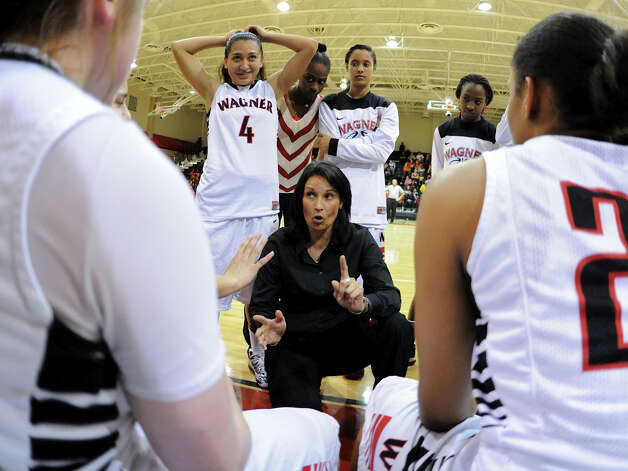 Wagner head coach Christina Camacho talks to her team during a timeout during a district 25-5A girls Basketball game between the Wagner Thunderbirds and the Judson Rockets at Wagner High School, Tuesday, January 29, 2013. 