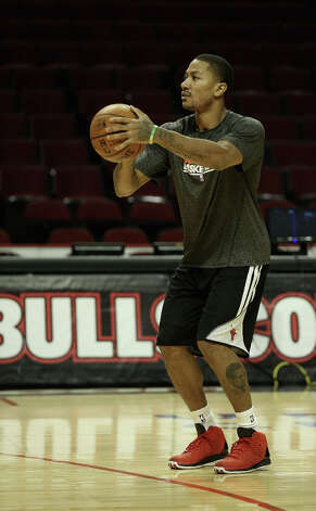 Derrick Rose #1 of the Chicago Bulls participates in a shoot-around before a game between the Bulls and the Phoenix Suns as he continues his rehab from knee surgery last May at the United Center on Jan. 12, 2013 in Chicago, Ill. Photo: Jonathan Daniel, Getty Images / 2013 Getty Images