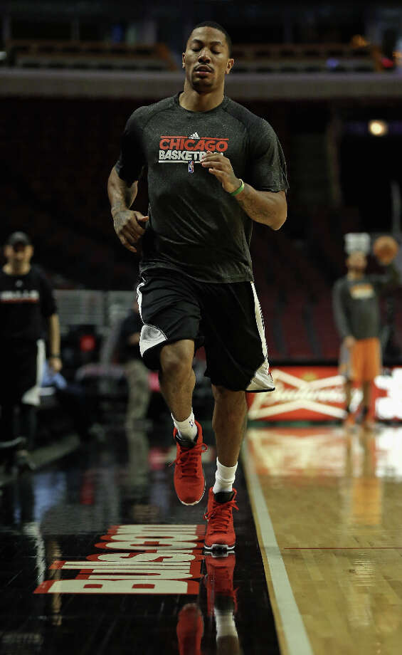 Derrick Rose #1 of the Chicago Bulls runs sprints during a shoot-around before a game between the Bulls and the Phoenix Suns as he continues his rehab from knee surgery last May at the United Center on Jan. 12, 2013 in Chicago, Ill. Photo: Jonathan Daniel, Getty Images / 2013 Getty Images