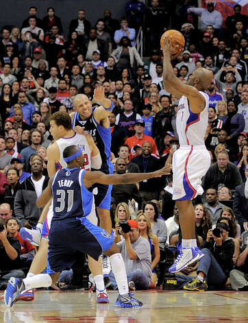 Los Angeles Clippers guard Chauncey Billups, right, shoots and hits a three point shot in the last few seconds of their NBA basketball game as Dallas Mavericks guard Jason Terry (31) defends along with guard Jason Kidd, center right, and Los Angeles Clippers forward Blake Griffin, top left, Wednesday, Jan. 18, 2012, in Los Angeles. The Clippers won 91-89. Photo: Mark J. Terrill, Associated Press / AP